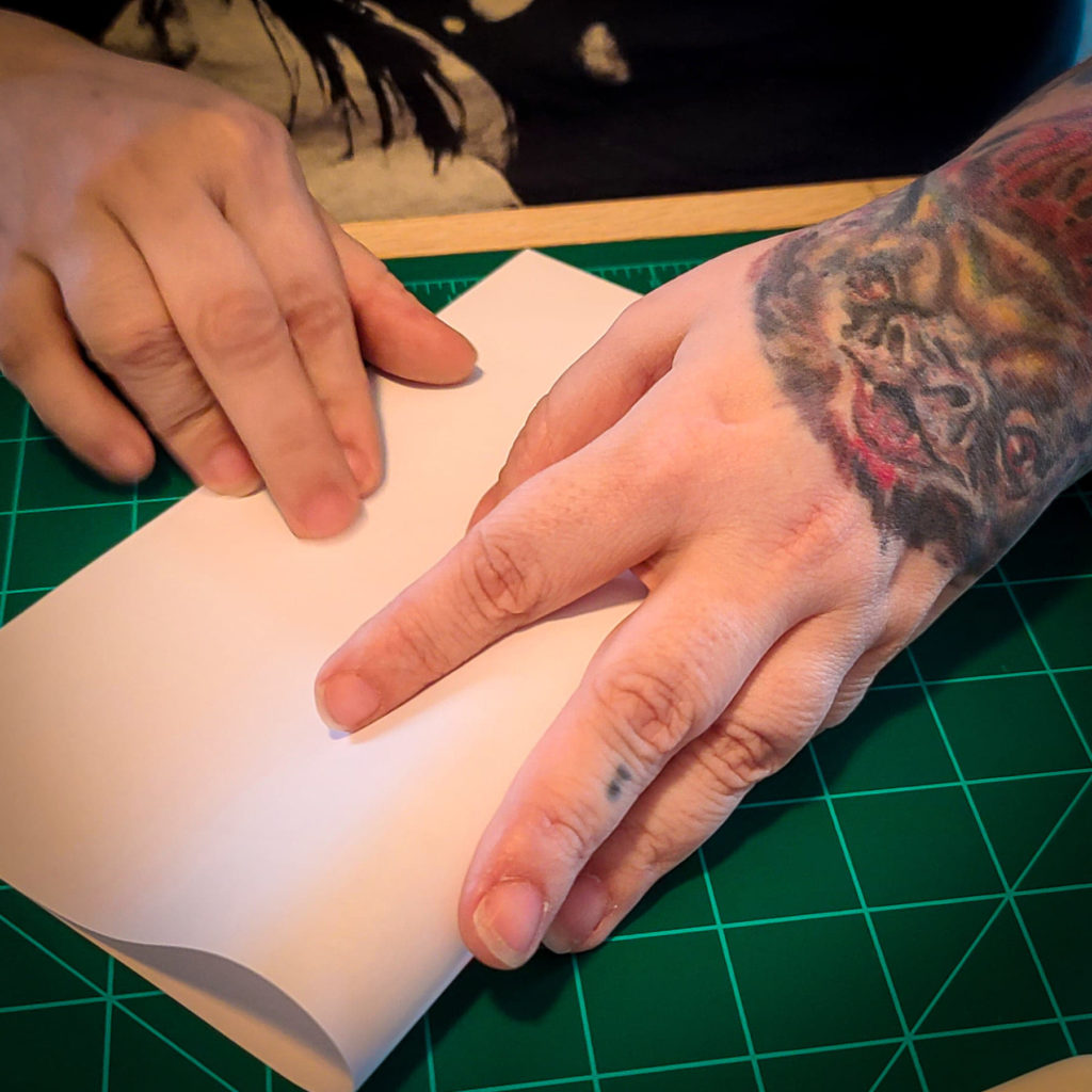 Hands Folding Paper Image